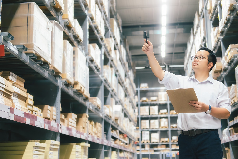 Worker checking inventory using an asset management app like Custella