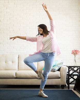 woman-dancing-home-happy.jpg