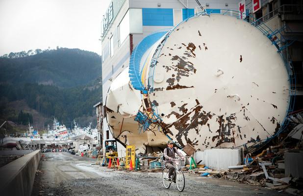 Kesennuma, the devastated city center. The inhabitants wander around town by bike. Many boats and ships were run aground.