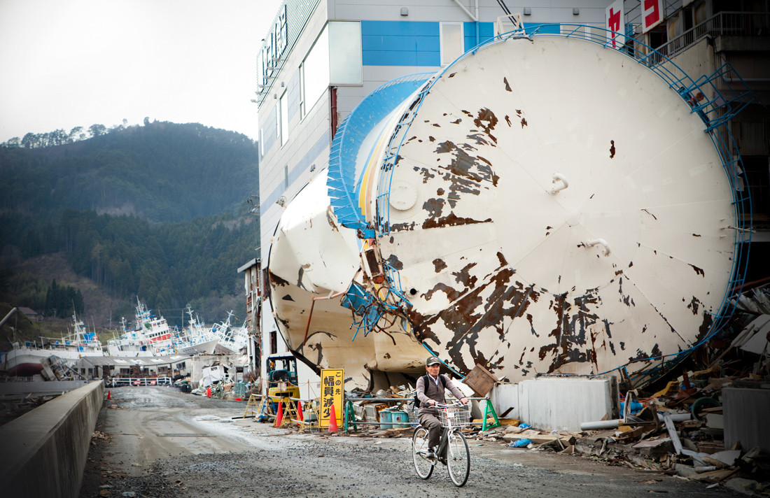 Kesennuma, the devastated city center. The inhabitants wander around town by bike. Many boats and ships were run aground.