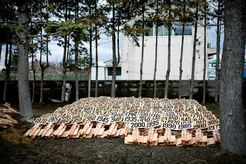 The temporary local cemetery in Ishinomaki, Miyagi prefecture. The stakes for the graves are numbered until 2000. This place was originally a football and baseball pitch and has been turned to a cemetery where some 2000 bodies will be buried. In Japan the bodies are usually cremated before burial, but because the victims were too many in Ishinomaki, they will be buried without cremation. This is an exceptional case in Japan.