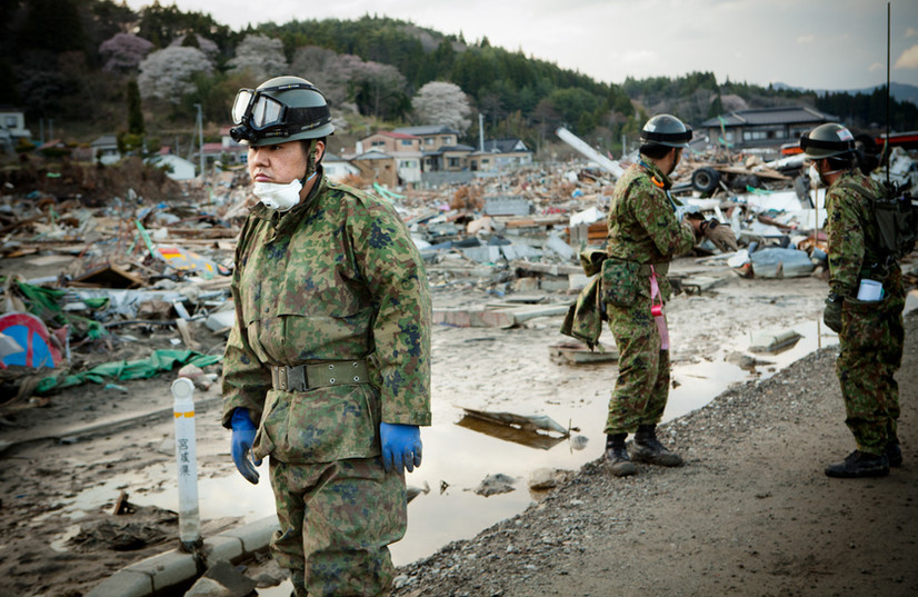 In Kesennuma, Miyagi prefecture, a soldier from the SDF, Japan's Self-Defence Forces, looks for the missing. Many of the soldiers, who were enrolled at the last moment, are severely shocked because of the total lack of experience.