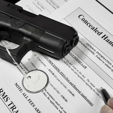 How can I legally carry a firearm in my car?