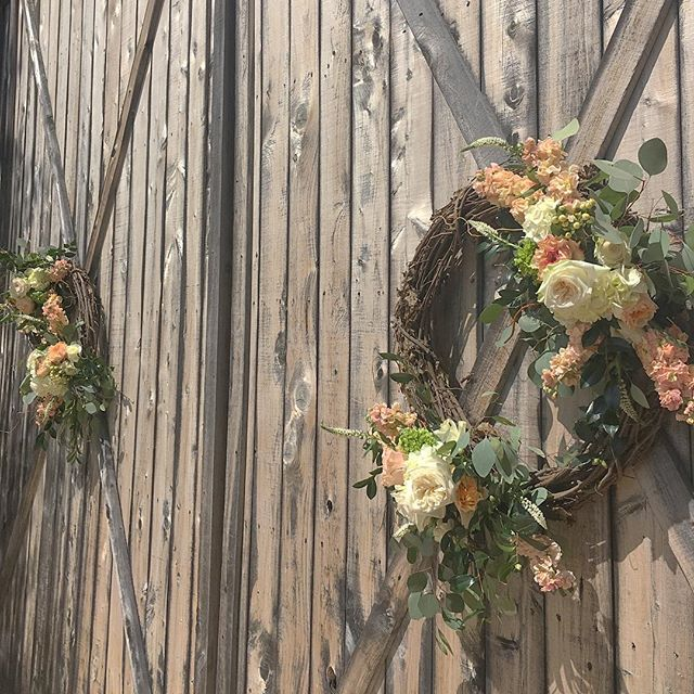 Barn door grapevine wreaths #Luella #wedding #middlegeorgiaflorist #GoWithTheCrowe