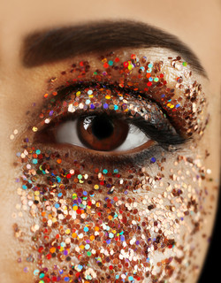 Female eye with fancy glitter makeup, ma