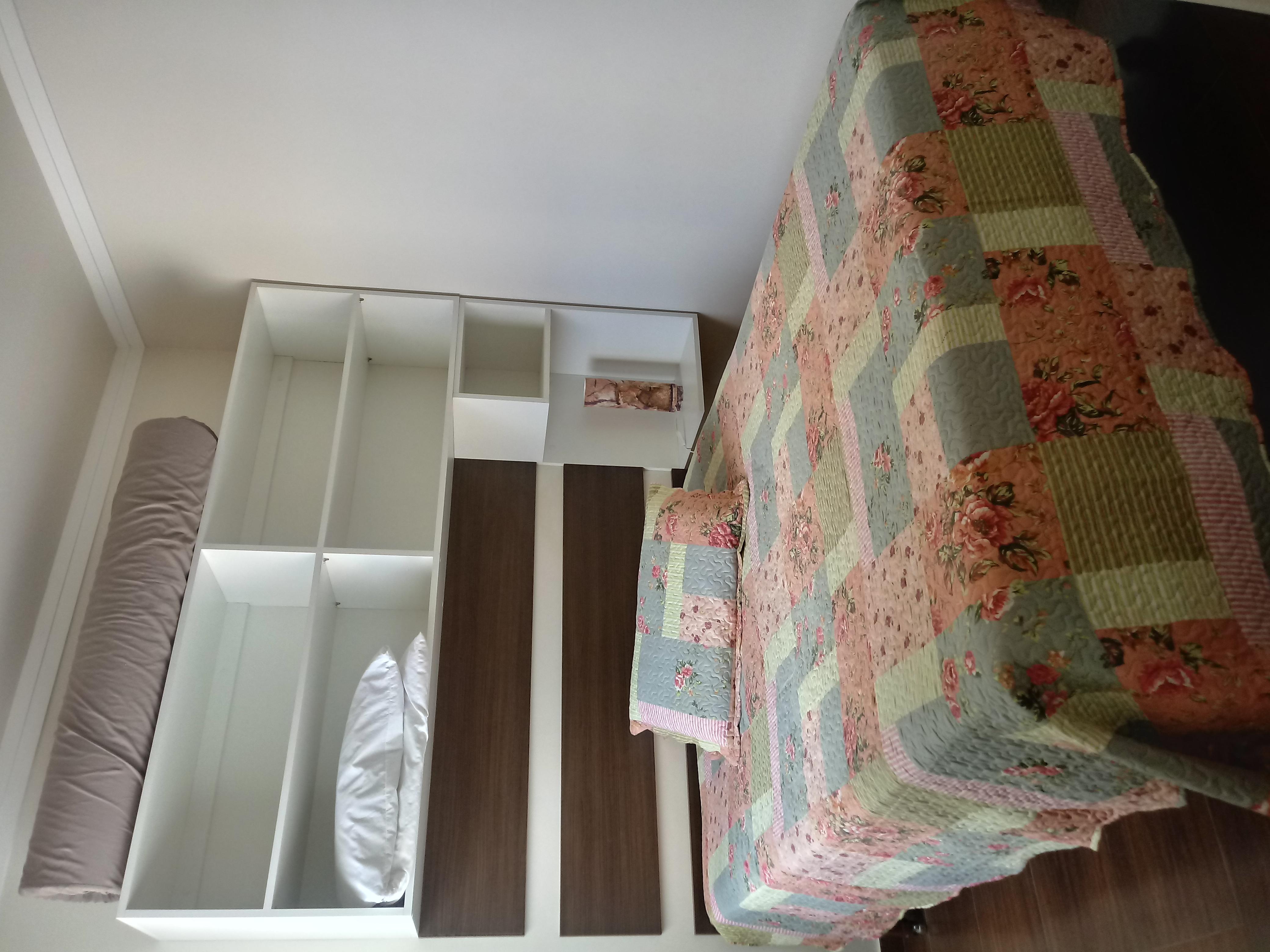 dormitório com janela para o mar