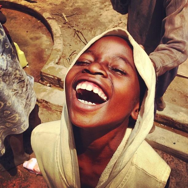 Boy smiling up in Rwanda