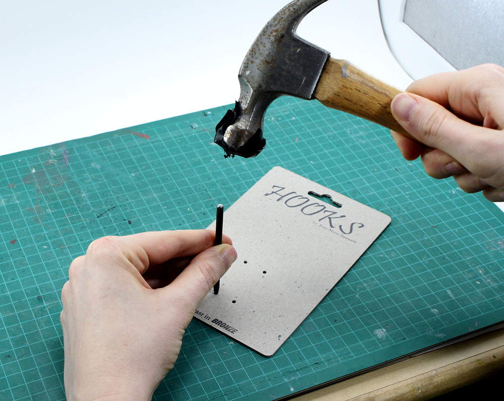 Punching holes in chipboard