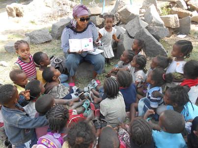 Desta reading at Tesfa Raey.JPG