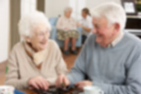 Couple Playing Dominoes At Day Care Cent