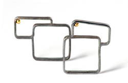 OFF-SET SQUARE RINGS