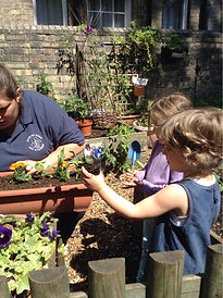Toddlers playing in Harvey Road Day Nursery's garden in Cambridge (polar room)