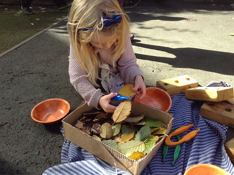 A child playing at Harvey Road Day Nursery in central Cambridge