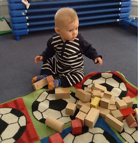 Baby playing with blocks in Harvey Road Day Nursery Cambridge