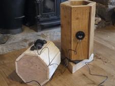 Bespoke wooden trunks receiving final audio mix.