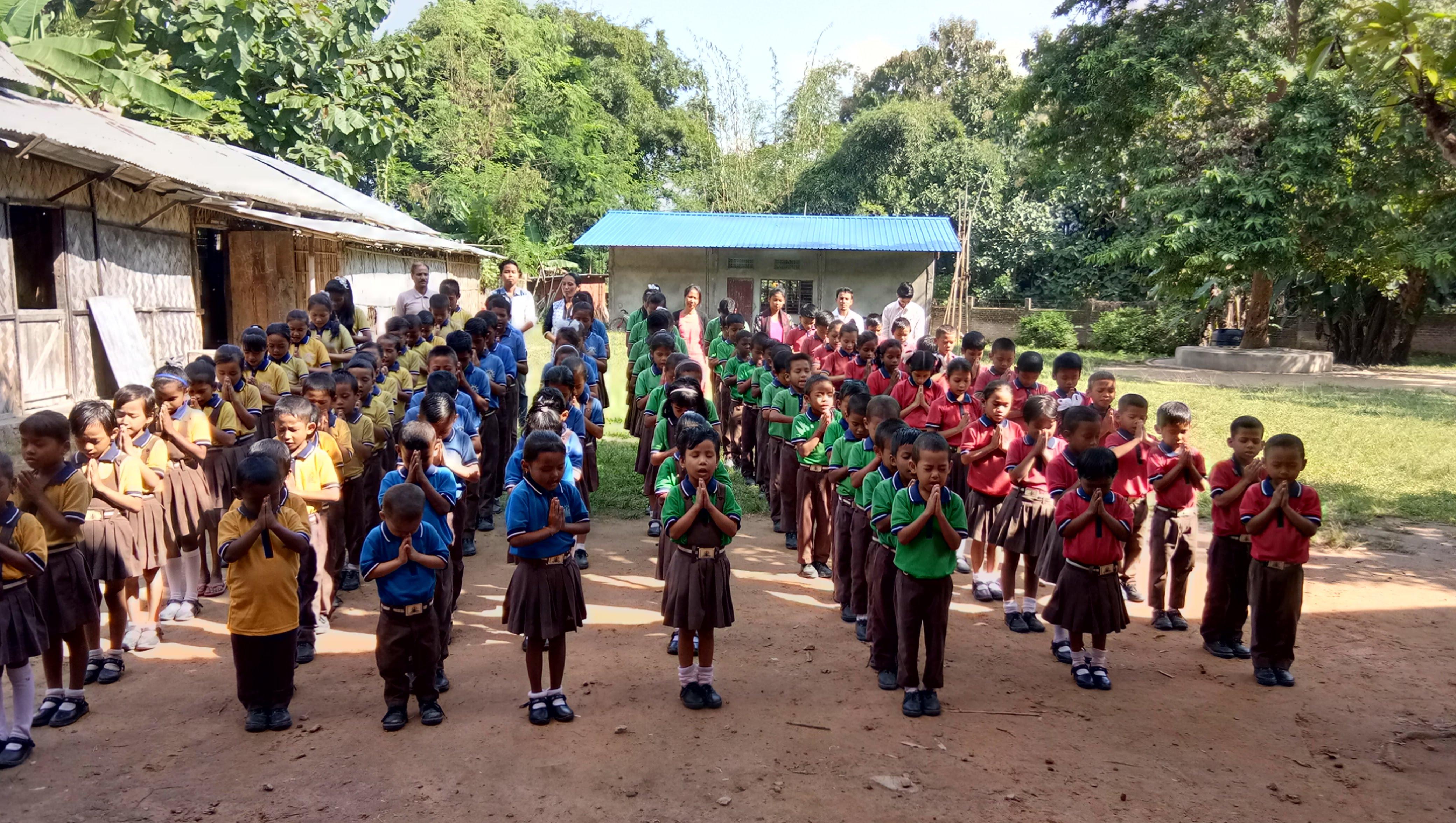 Our school children praying