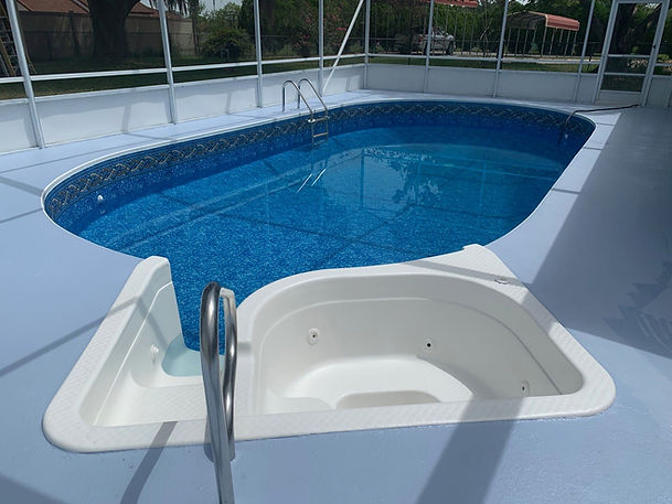 Screened in Pool Enclosure, New paint on the pool deck and the hot tub and a new blue liner installed on an in-ground pool