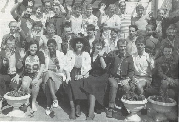 Black and white photo of a group of people celebrating Switchboard's 10th anniversary
