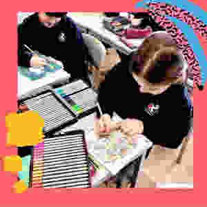 children working on their Happy Space mental wellbeing guidebook