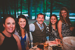 Group of happy wedding reception guests.