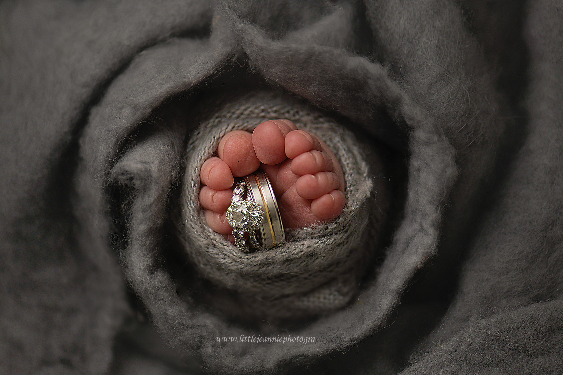 baby toes with wedding rings photos