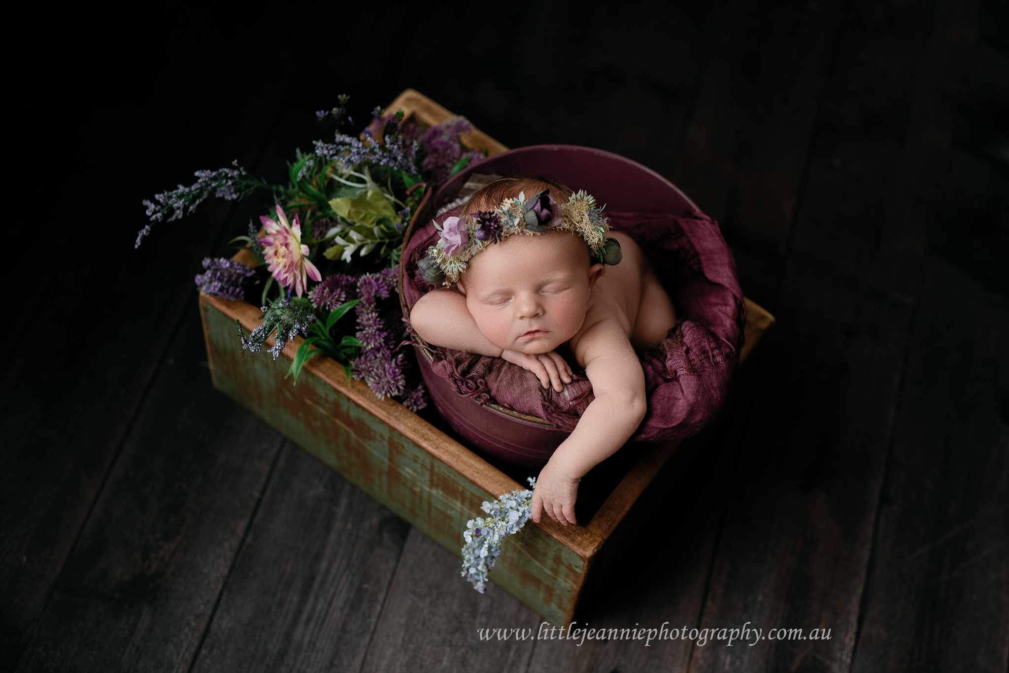 Newborn with flowers photography