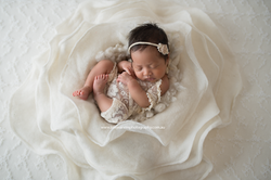 Baby girl in floral set-up