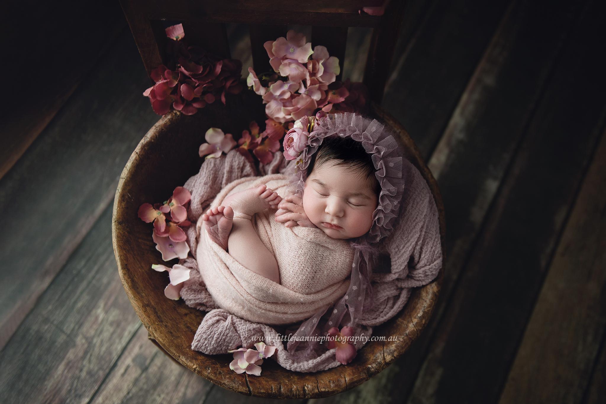 Newborn with flowers photos