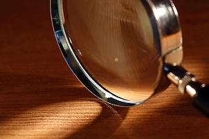 Extreme closeup of magnifying glass stan