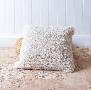 Cream woolly cushion
