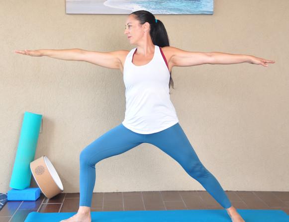 Josie in warrior two yoga pose