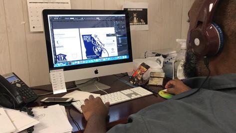Senior Designer, Antar prepping plates for a screen printing job.