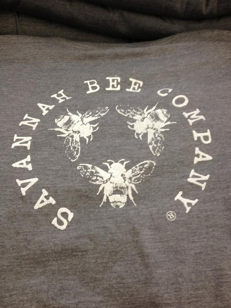 Water based ink and discharge ink make very soft prints like this Savannah Bee Company shirt.