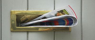 Leaflet through a door post