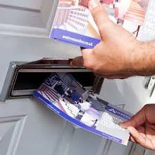 putting leaflet in a door post