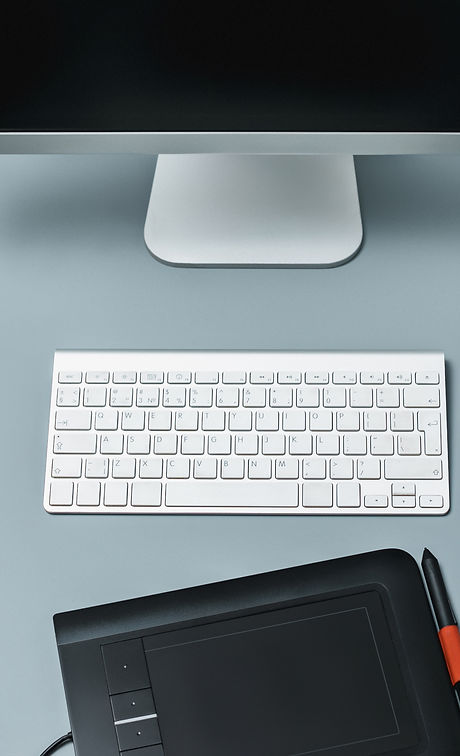 gray-desk-with-laptop-notepad-with-blank