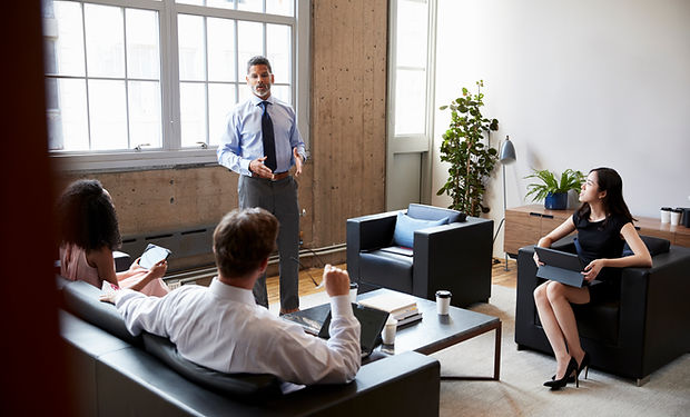 male-manager-stands-at-an-informal-loung