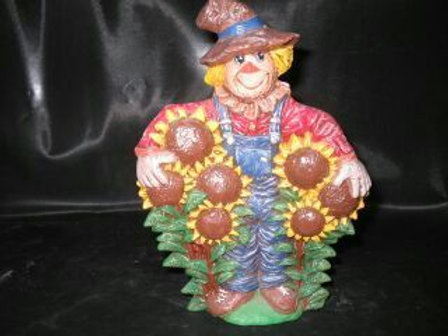 Scarecrow with sunflowers