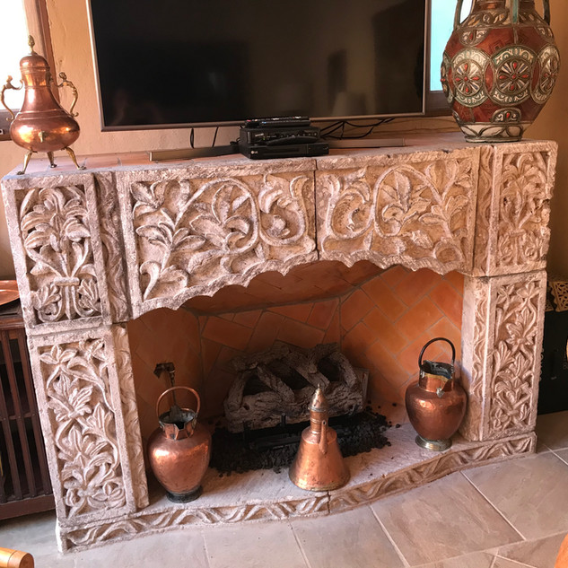 Cantere fireplace in the game room .jpg