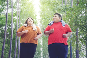 obese couple laughing.jpeg