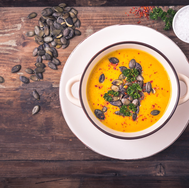 Canva - Pumpkin soup with pumpkin seeds