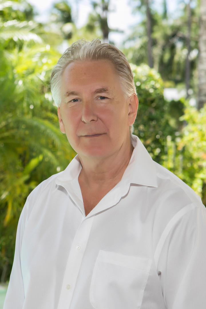 male in white button down