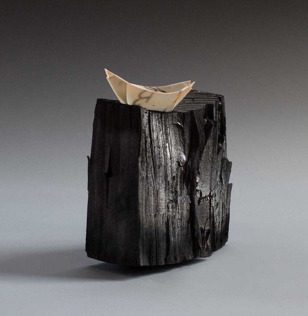 Precipice, translucent porcelain boat and charred wood