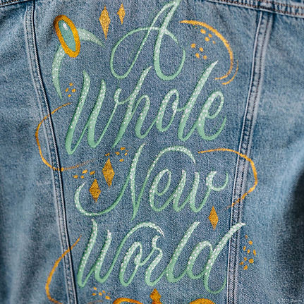 A customised denim jacket inspired by the Disney Princess Jasmine from Aladdin. This hand-
