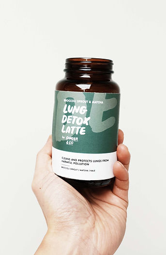 A green bottle containing a herbal latte mix called Lung Detox Latte