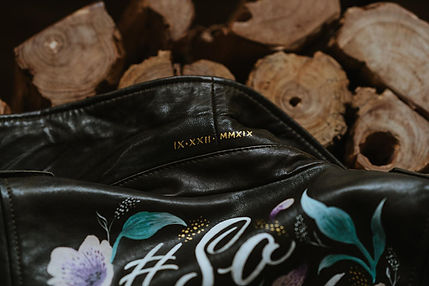 A hand-painted bridal leather jacket, customised with the bride's name in elegant script l