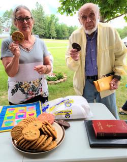 Paula Tupa & John Hallman enjoying a cookie at the Ice Cream Social at St Mary's