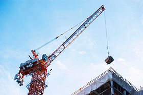 Crane lifting on construction site