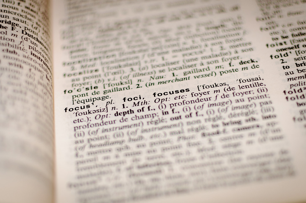 """dictionary text with the definition for """"focus"""" zoomed in on"""