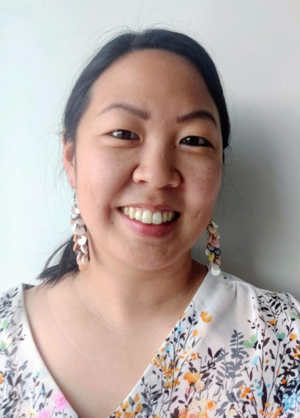 photo of Crystal Shelley wearing dangly earrings and a floral top